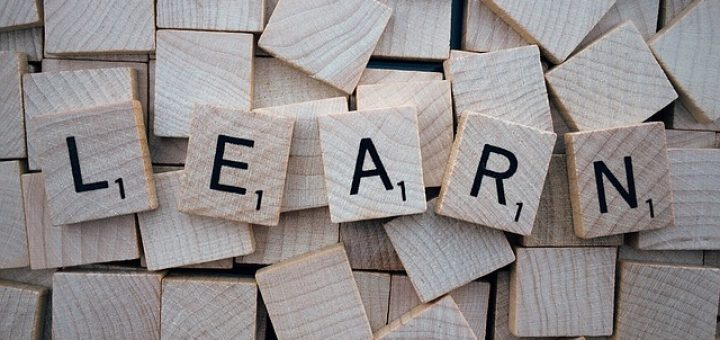 """Learn"" spelled in Scrabble pieces"