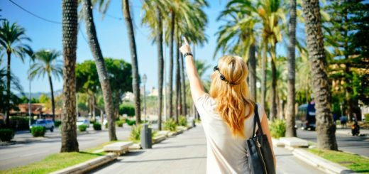 woman on vacation pointing and understanding the importance of work life balance