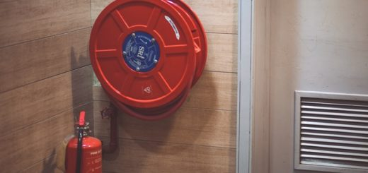 red fire extinguisher and fire hose for office fire safety